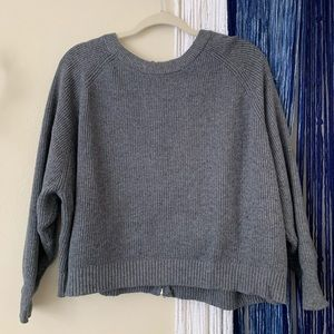 Gray cropped sweater with zipper up the back